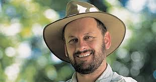 Tim Flannery wearing a hat