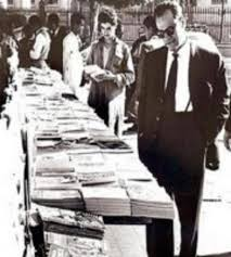 man searching old books