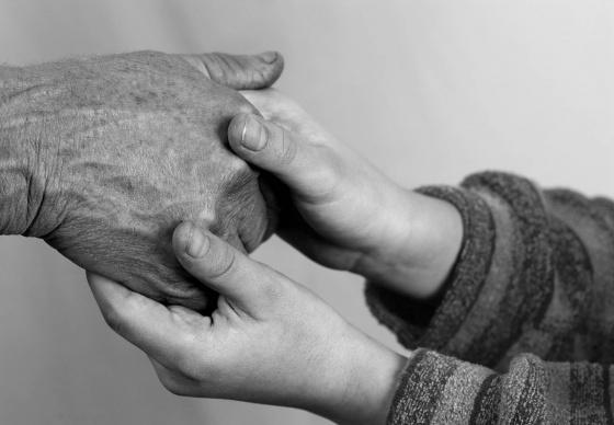 Young hands holder an elder's hand