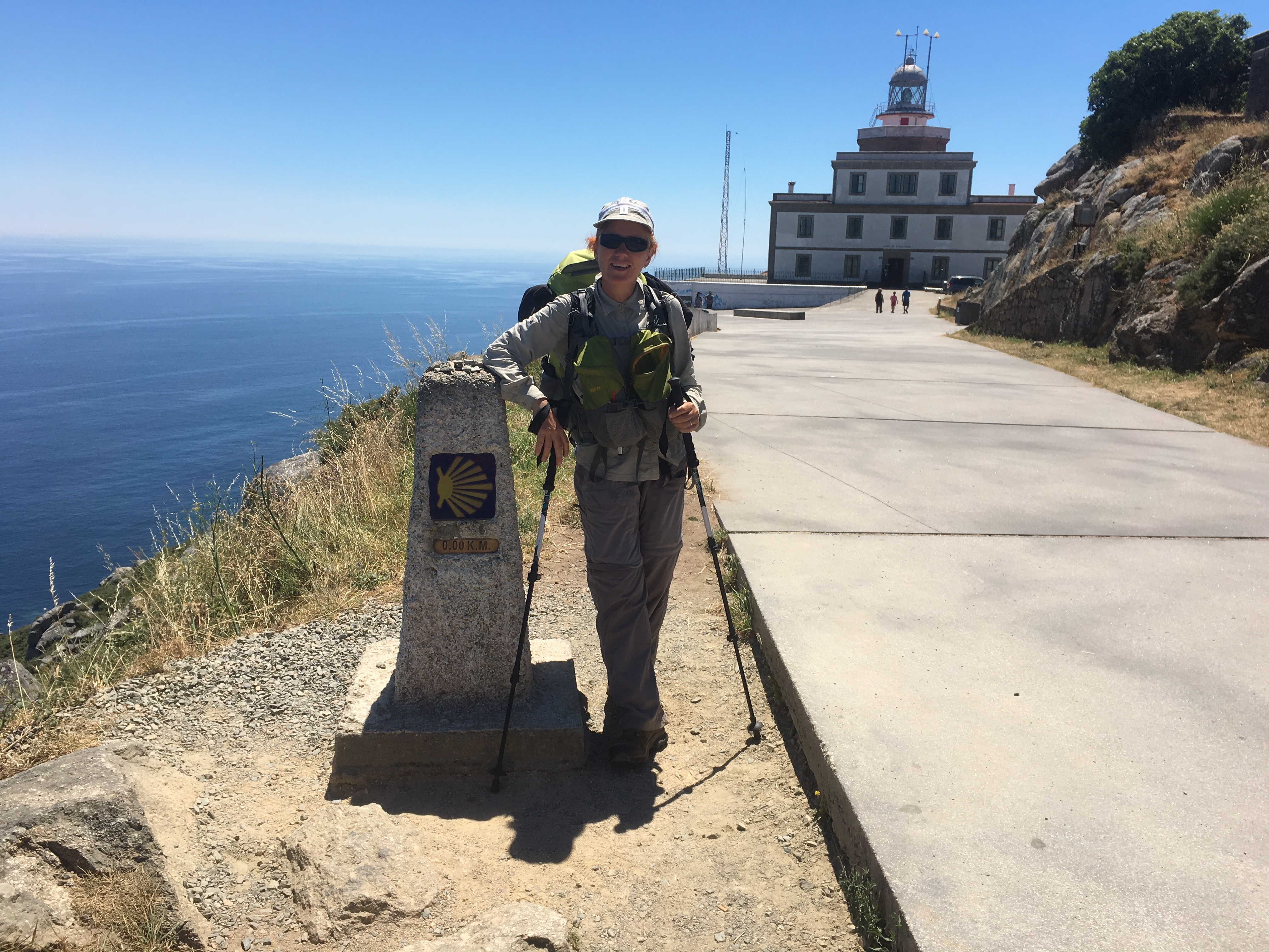 Victoria Osborne leaning on the final milepost in the Camino across Spain