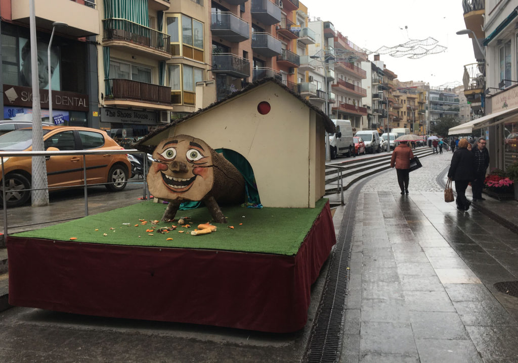 The giant Tió at Blanes. No mere blanket here - they've built a house for the log to defecate into .