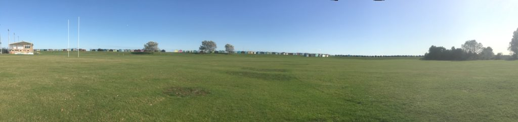 Beach huts surrounding the playing fields at Harwich