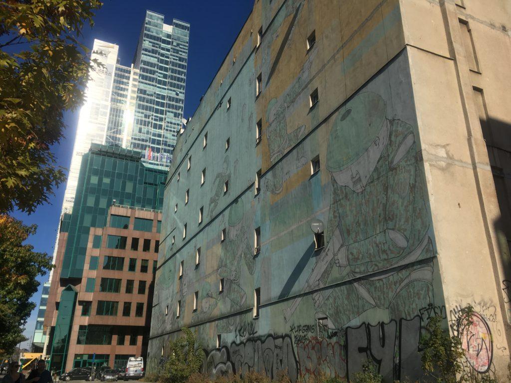 Warsaws growth flanks memorial mural