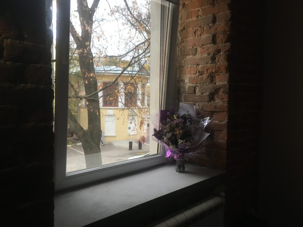 Sad dried flowers in hostel. Which girl do they belong to? Can you see him leaving in the background?