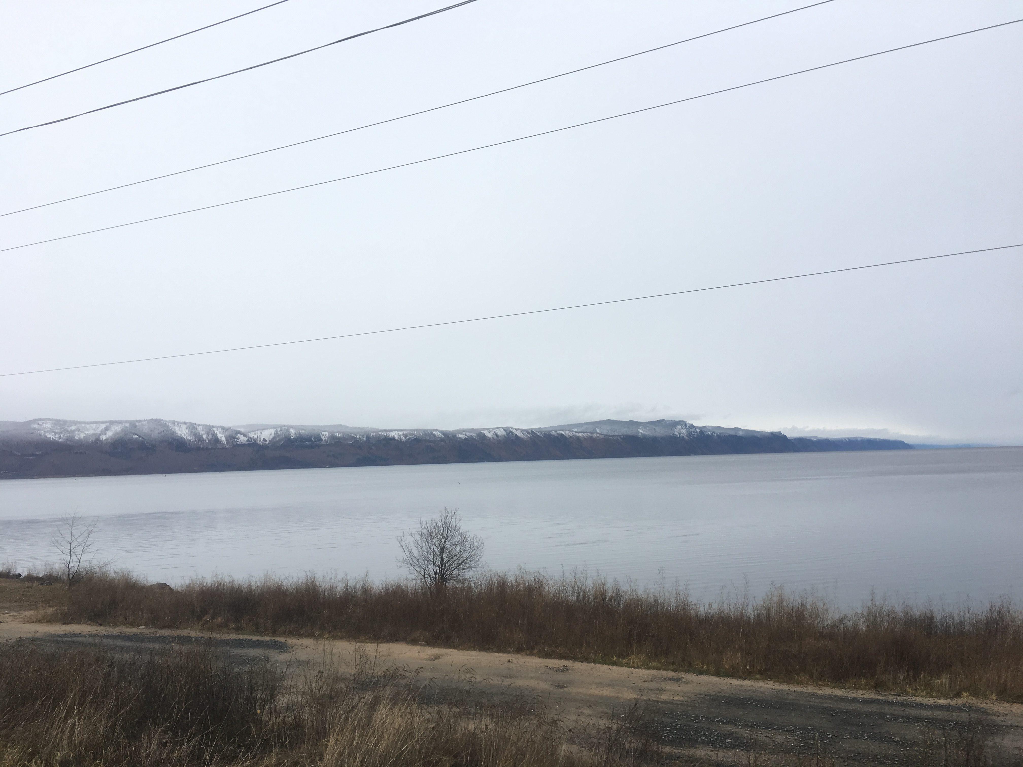 Snow-capped hills by Lake Baikal