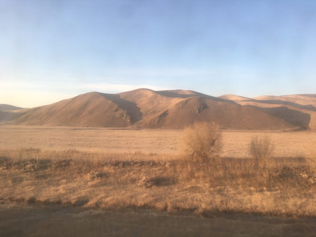 Mongolian hills take on the shape of sand dunes