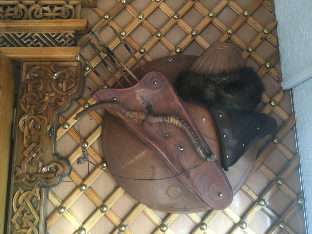 Mongolian bow and arrows, hat and shield; restaurant decoration