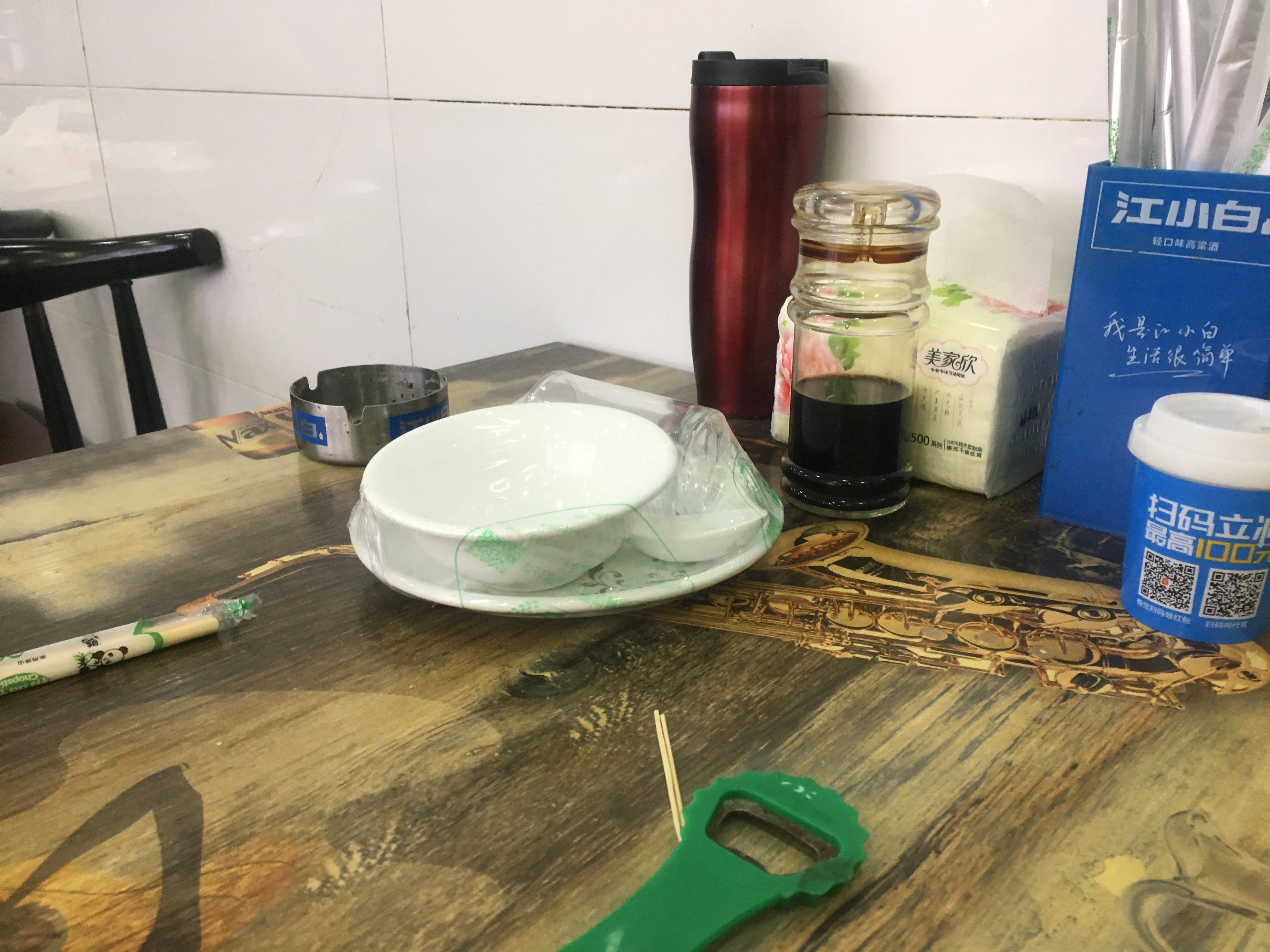Plastic sealed crockery at Ningbo cafe