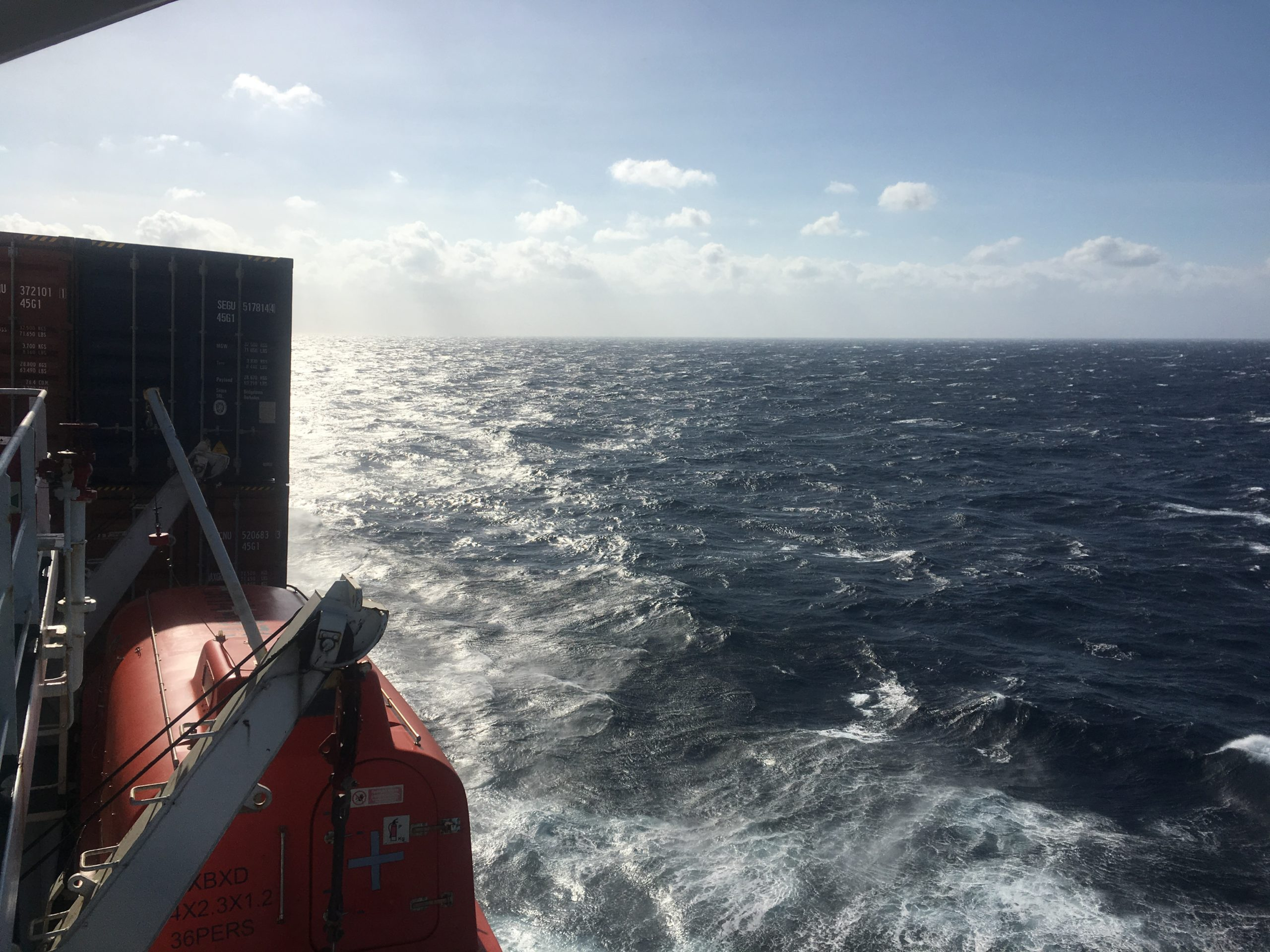 Lifeboat on CC Coral and sun on the Philippine Sea