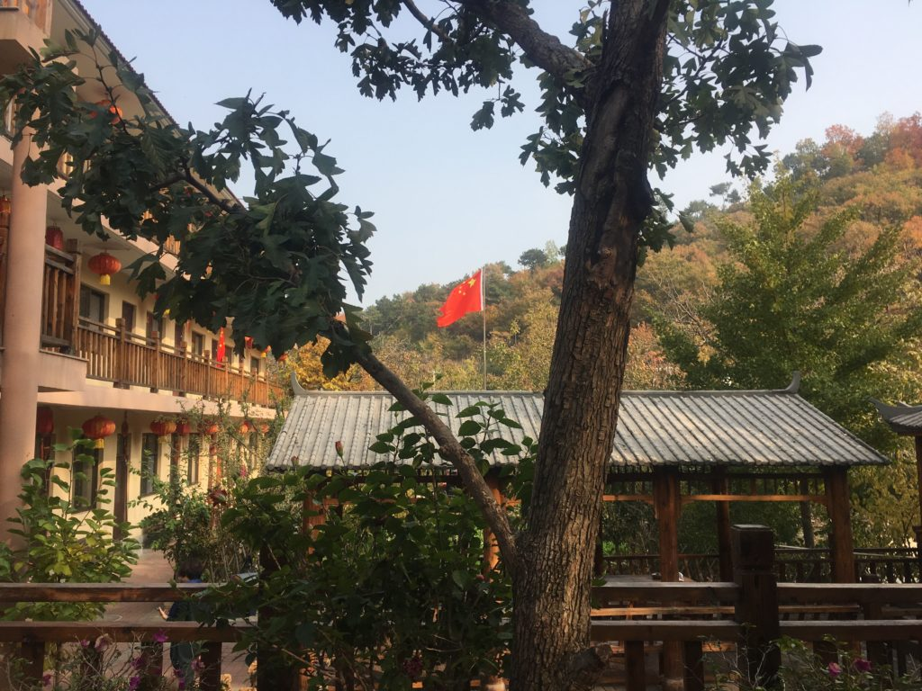 Chinese flag flutters over the guest house