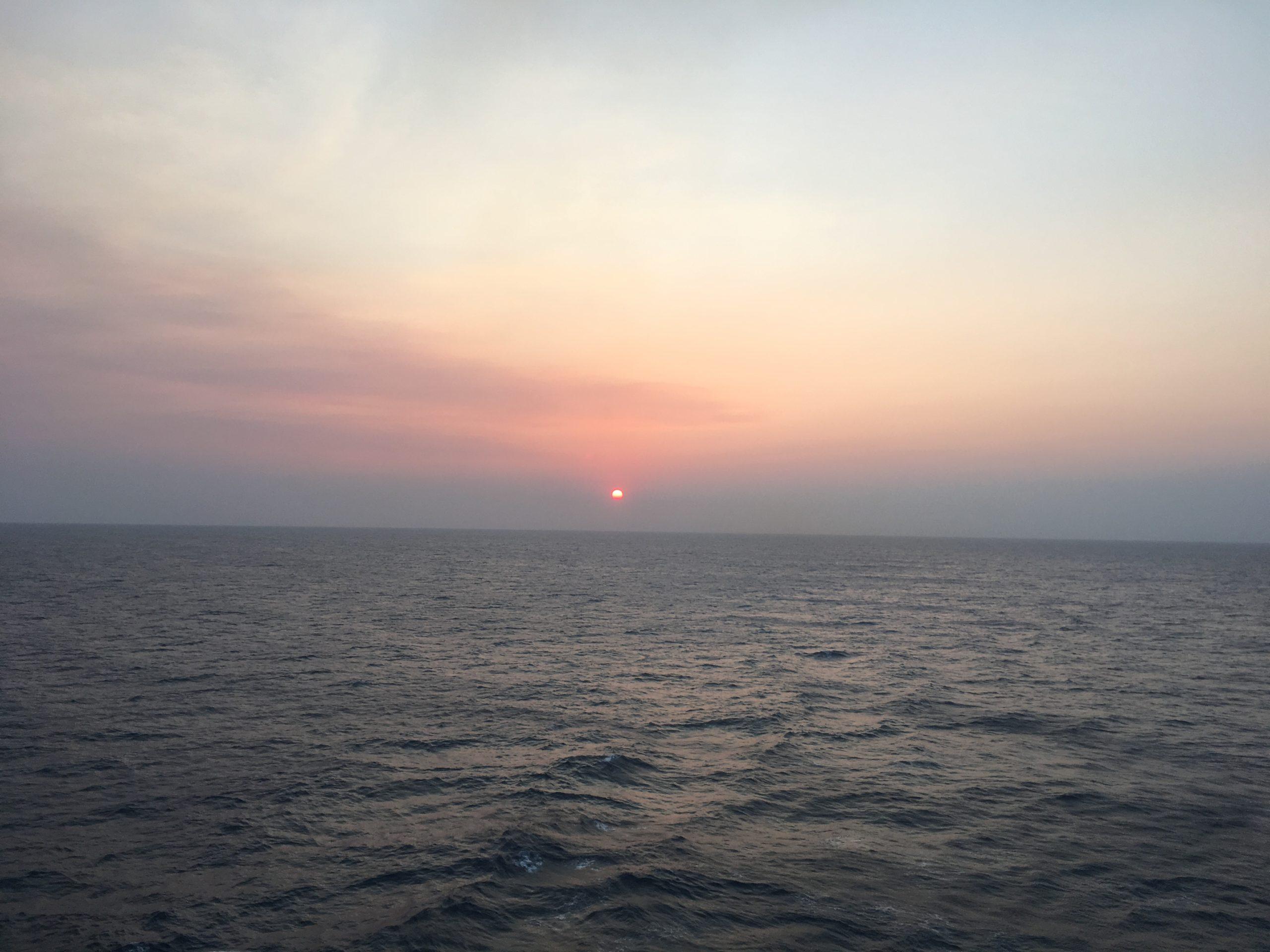Sun sinking into bushfire haze CC Coral going SE
