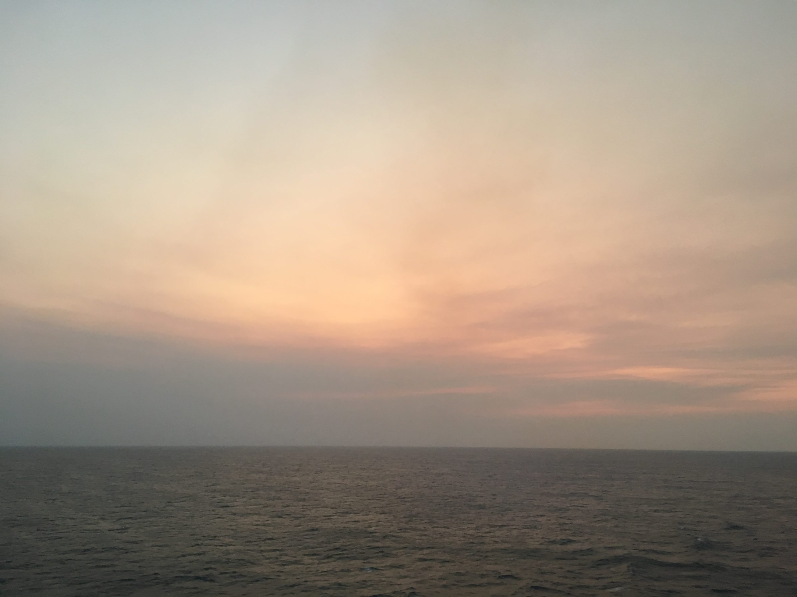 Sun gone smoke remains Coral Sea