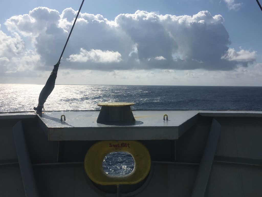 CC Coral bow decorated by some fulsome clouds in the Tasman Sea