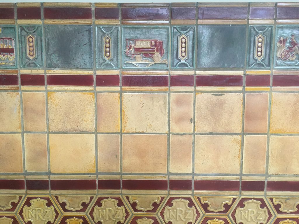 Tiles on the Auckland Central Hotel walls still depict train themes
