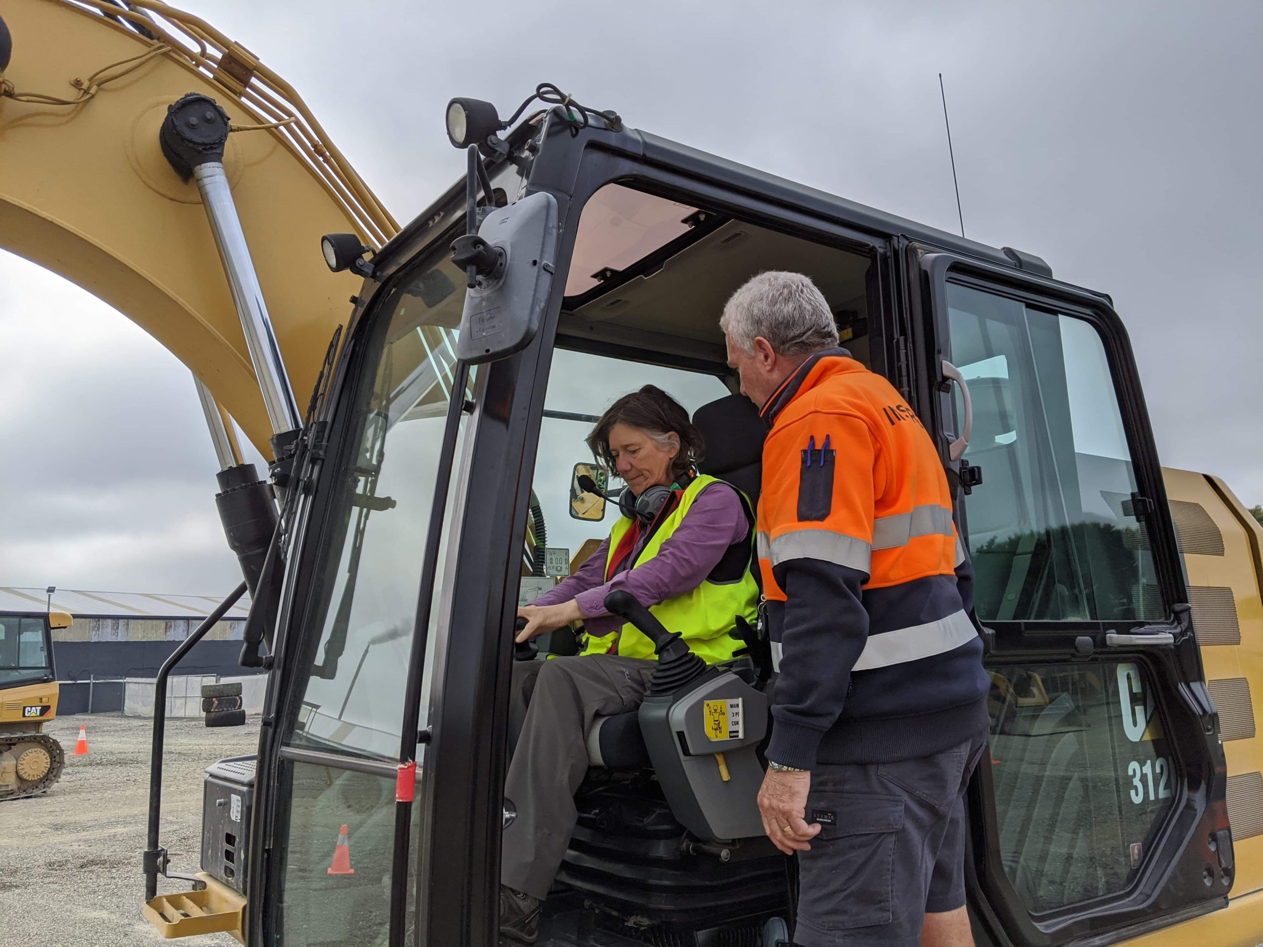 Colin shows me some of the basics in the digger