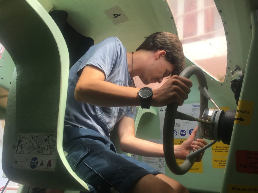 Andrew gets to turn on the engine in the lifeboat Ontario II