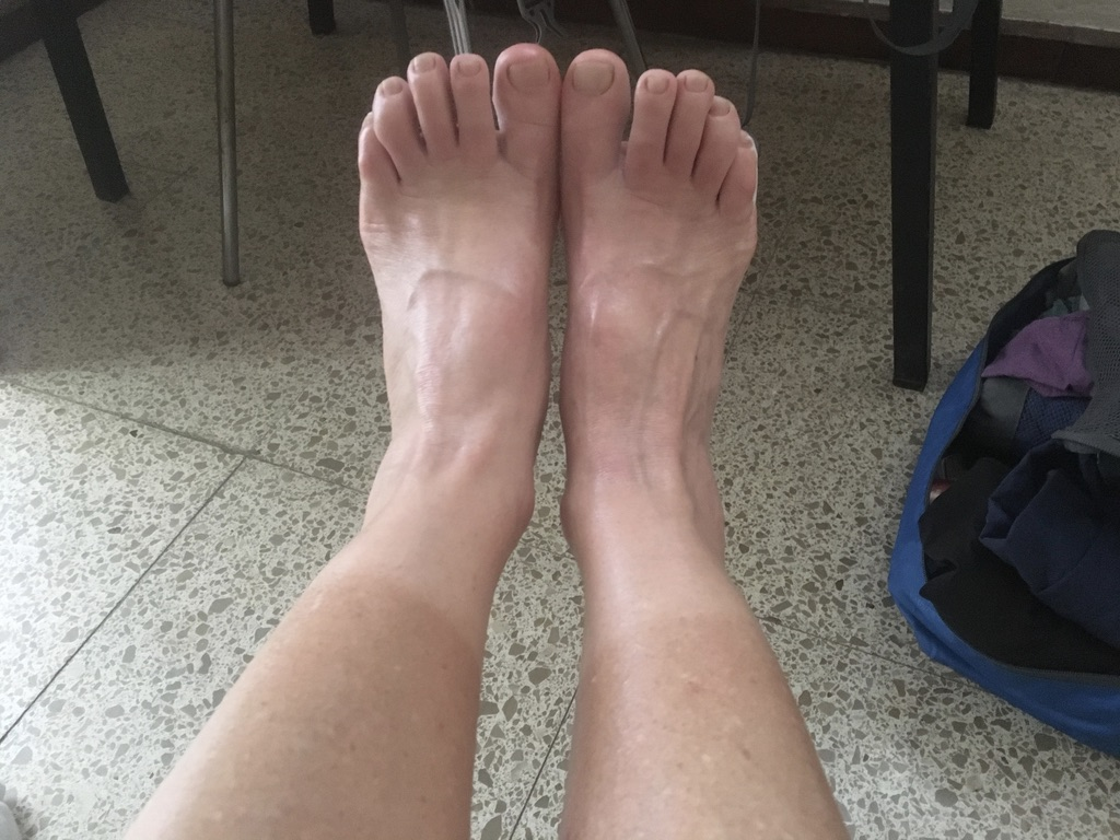 Feet resting in Santiago - note tan lines